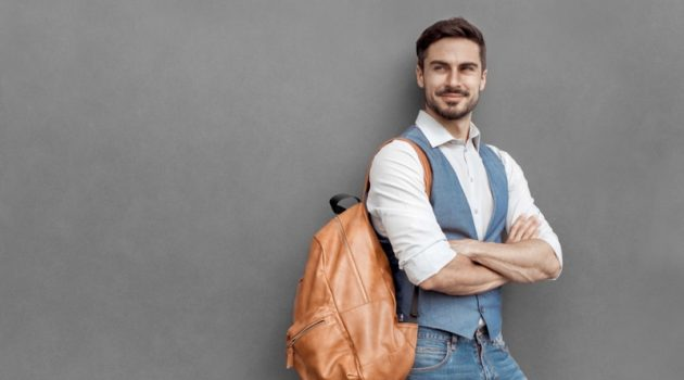 Well Dressed Man Brown Backpack Vest Jeans