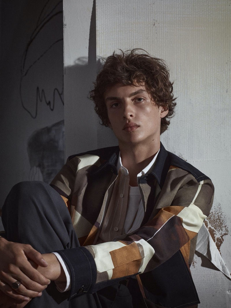 Lucas El Bali is an elegant vision as he layers in an abstract print shirt and striped top for Zara's fall-winter 2020 men's campaign.