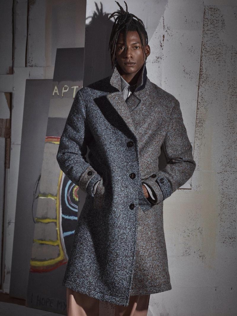 Ty Ogunkoya models a duo-tone herringbone coat for Zara's fall-winter 2020 men's campaign.