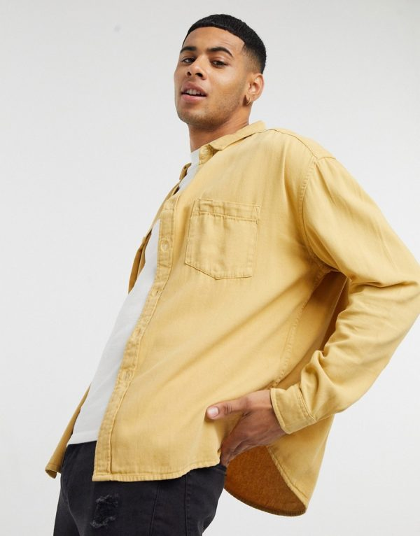 ASOS DESIGN 90s oversized organic denim shirt in mustard-Yellow