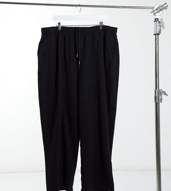 ASOS DESIGN Plus organic super oversized sweatpants in black with toggle hem