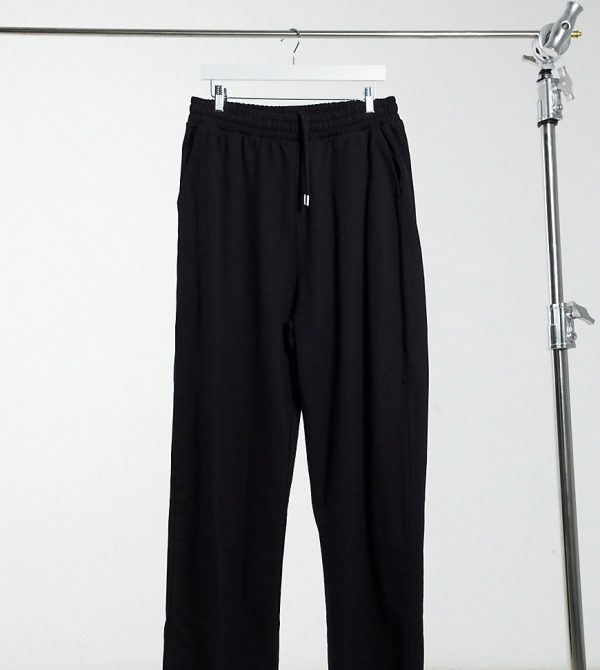 ASOS DESIGN Tall organic super oversized sweatpants in black with toggle hem