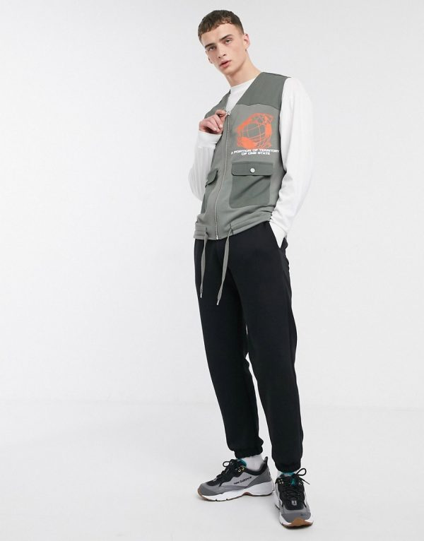 ASOS DESIGN jersey utility vest with print detail & woven pockets in khaki-Green