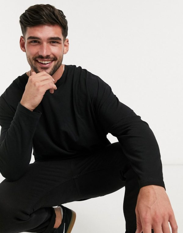 ASOS DESIGN oversized long sleeve t-shirt with raw notch neck in black