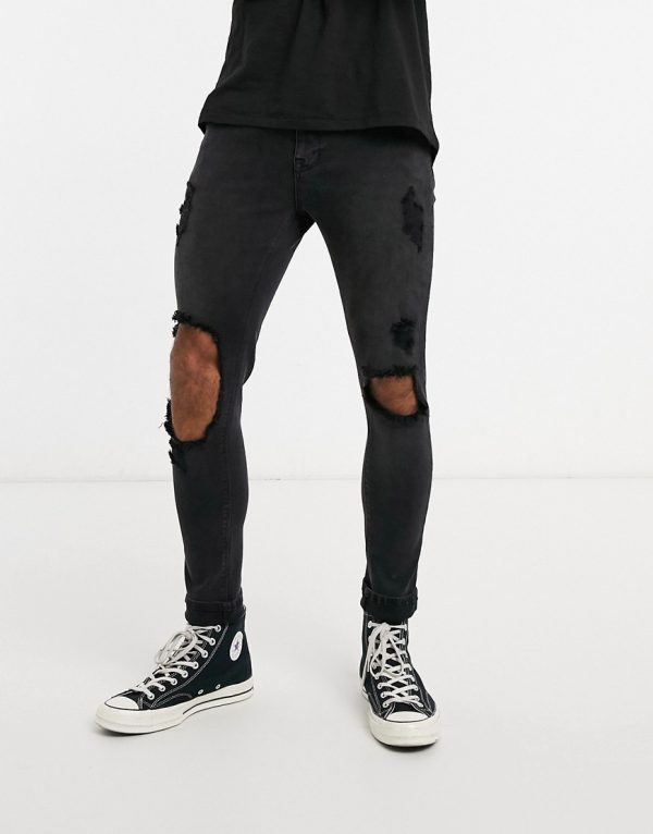ASOS DESIGN spray on jeans in power stretch with open rips in washed black