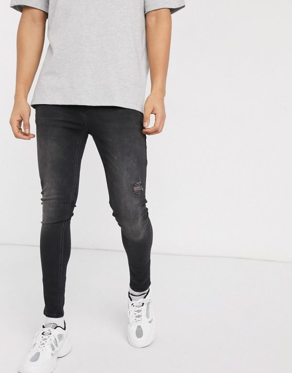 ASOS DESIGN spray on jeans in power stretch with rips and raw hem in washed black