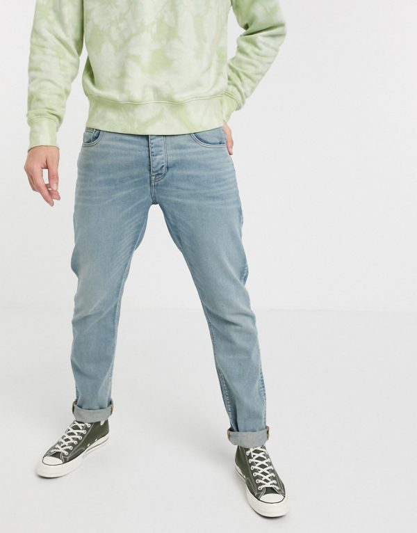 ASOS DESIGN stretch slim jeans in light wash blue