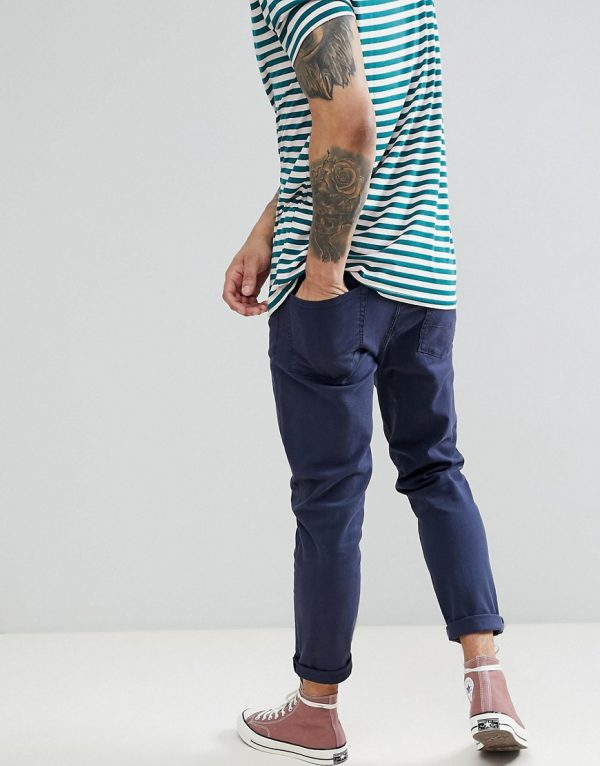 ASOS DESIGN tapered jeans in navy
