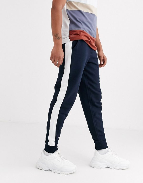 ASOS DESIGN tapered jogger with side stripe in navy