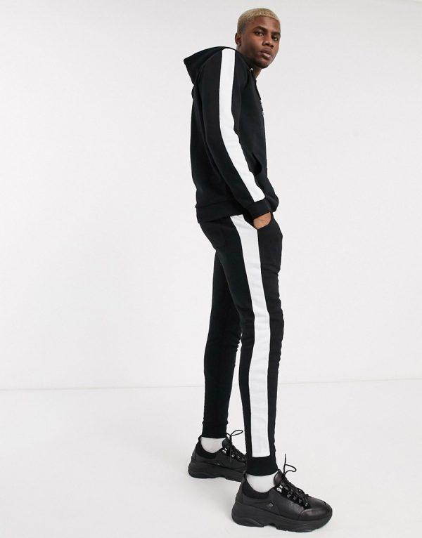 ASOS DESIGN tracksuit with side stripe in black