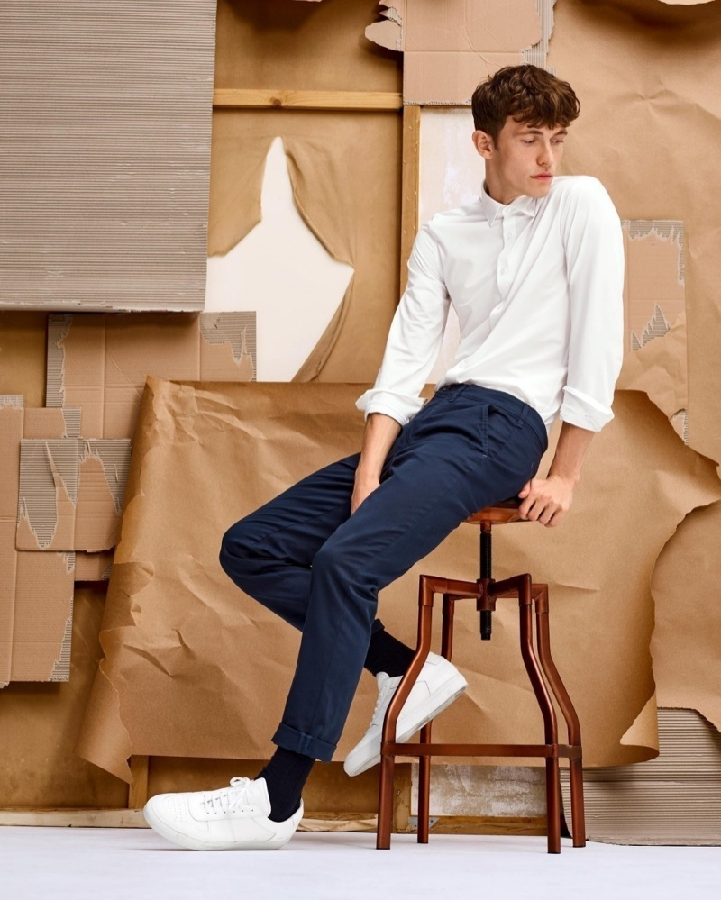 Christoffer Barsø dons a smart and timeless look, consisting of a white shirt and navy chinos, for Anson's fall-winter 2020 campaign.