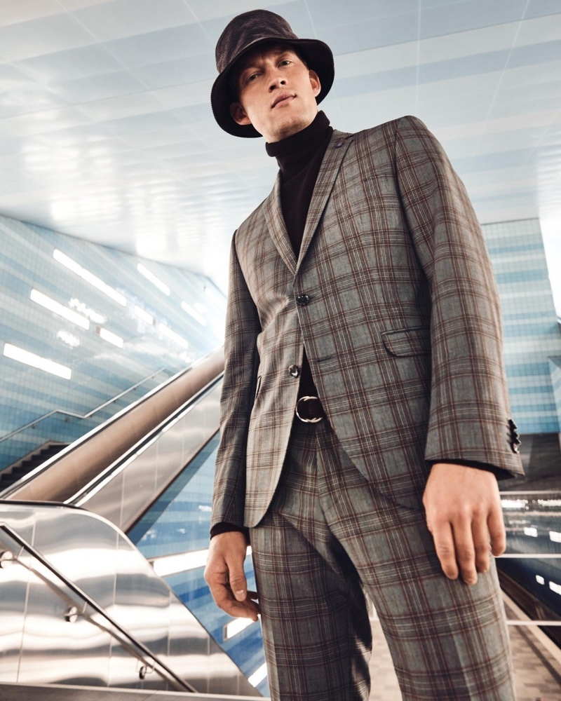 Bastian Thiery sports a checked suit with a turtleneck sweater and bucket hat for Anson's fall-winter 2020 campaign.
