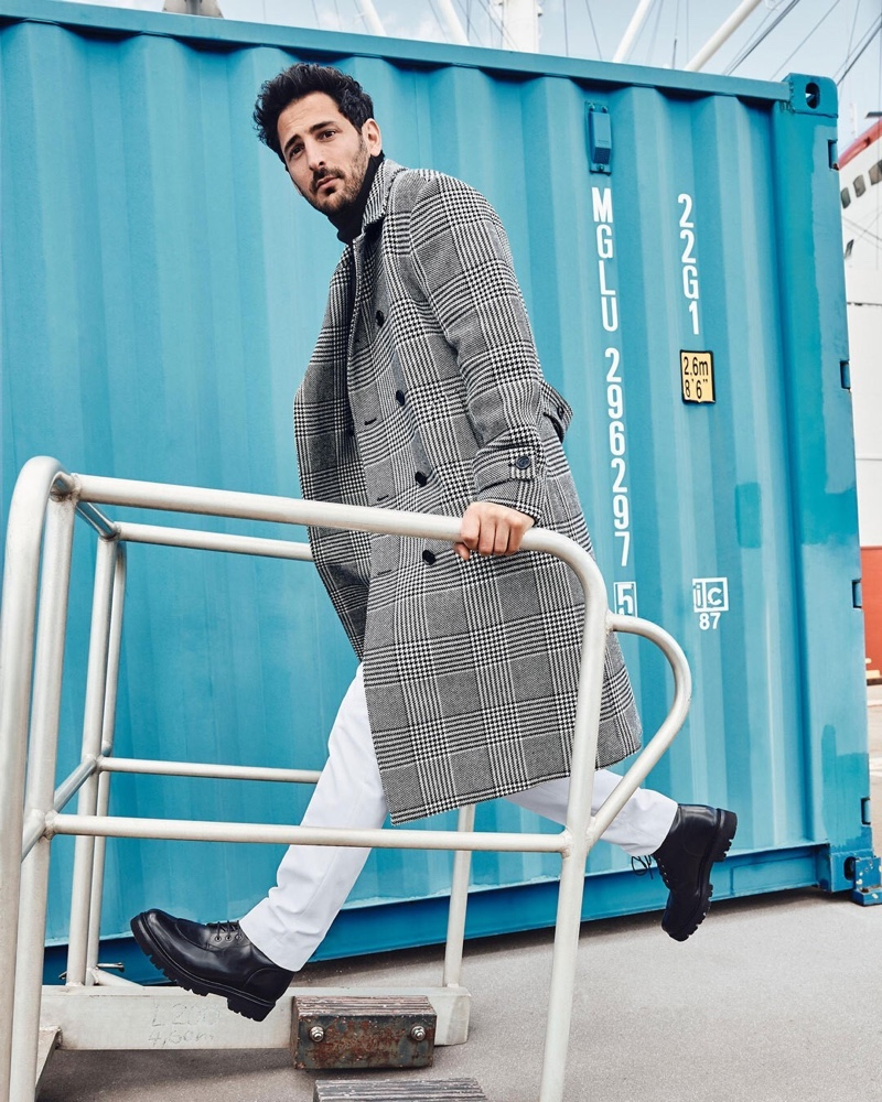 Selle Coskun sports a checked double-breasted coat with Tiger of Sweden chinos for Anson's fall-winter 2020 campaign.