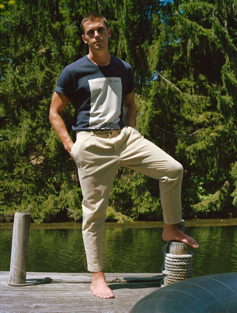 Pictured outdoors, Antoni Porowski dons The Easy Tee with pleated trousers from his J Brand collection.