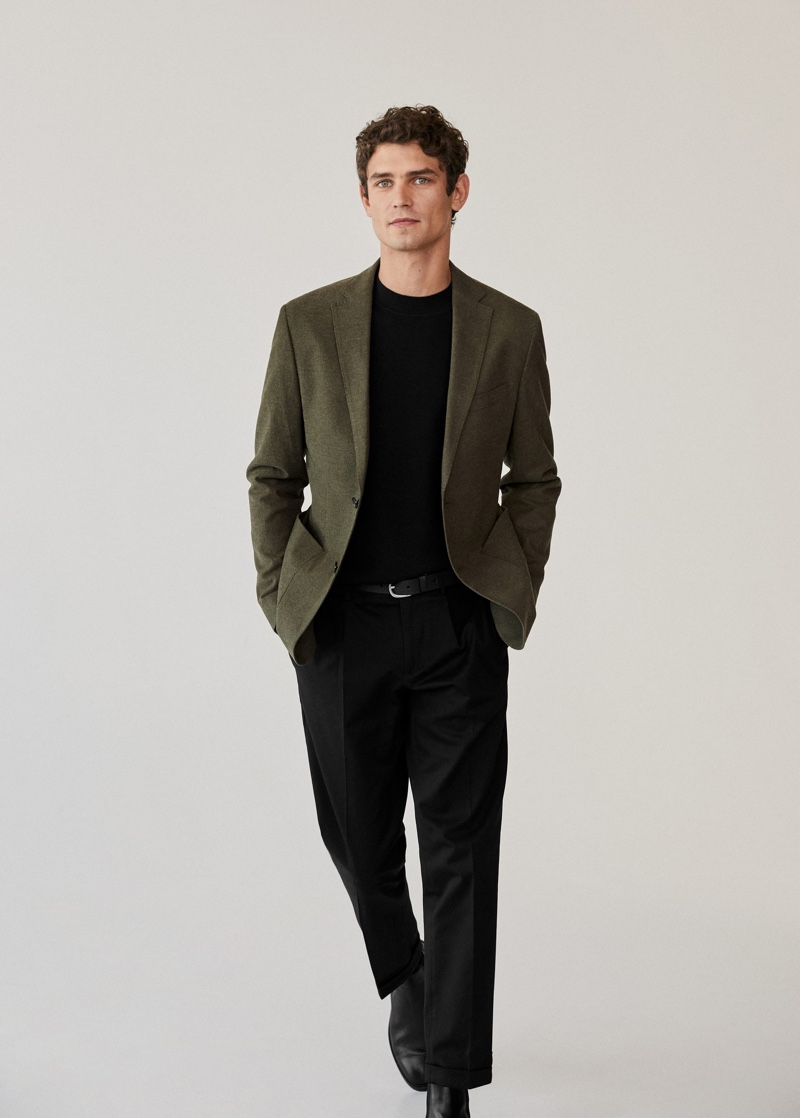 Showcasing smart style from Mango, Arthur Gosse wears a slim-fit cotton blazer with pleated slim-fit chinos.