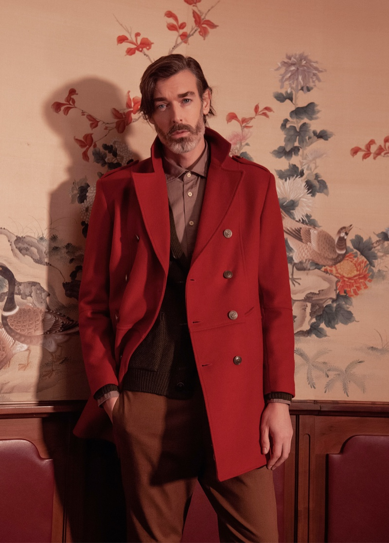 Richard Biedul dons an elegant coat in red for Besilent's fall-winter 2020 campaign.