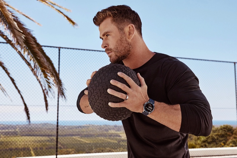 Working out, Chris Hemsworth sports a TAG Heuer Connected watch for the brand's latest advertisement.