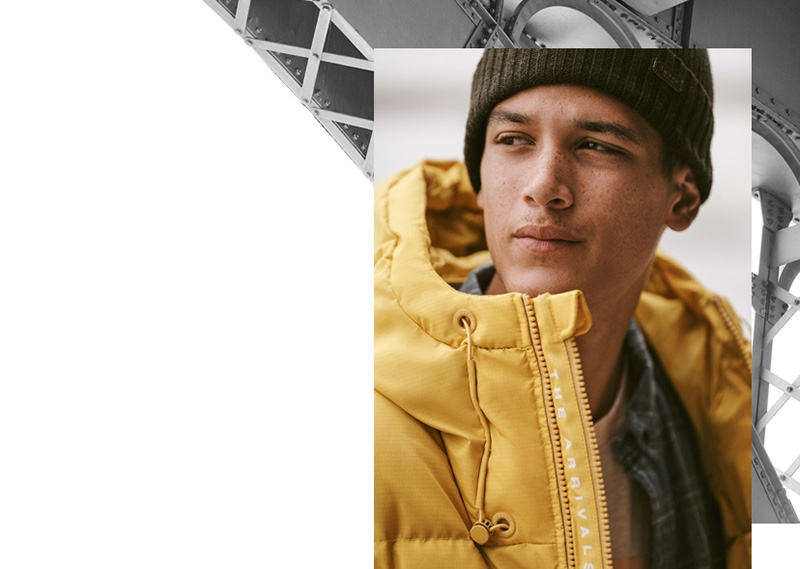 Model Marco Pickett sports an AER classic down puffer jacket in saffron ripstop from The Arrivals.