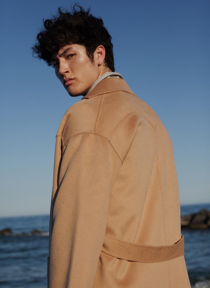 Brandon wears jacket Zegna and coat Nanushka.