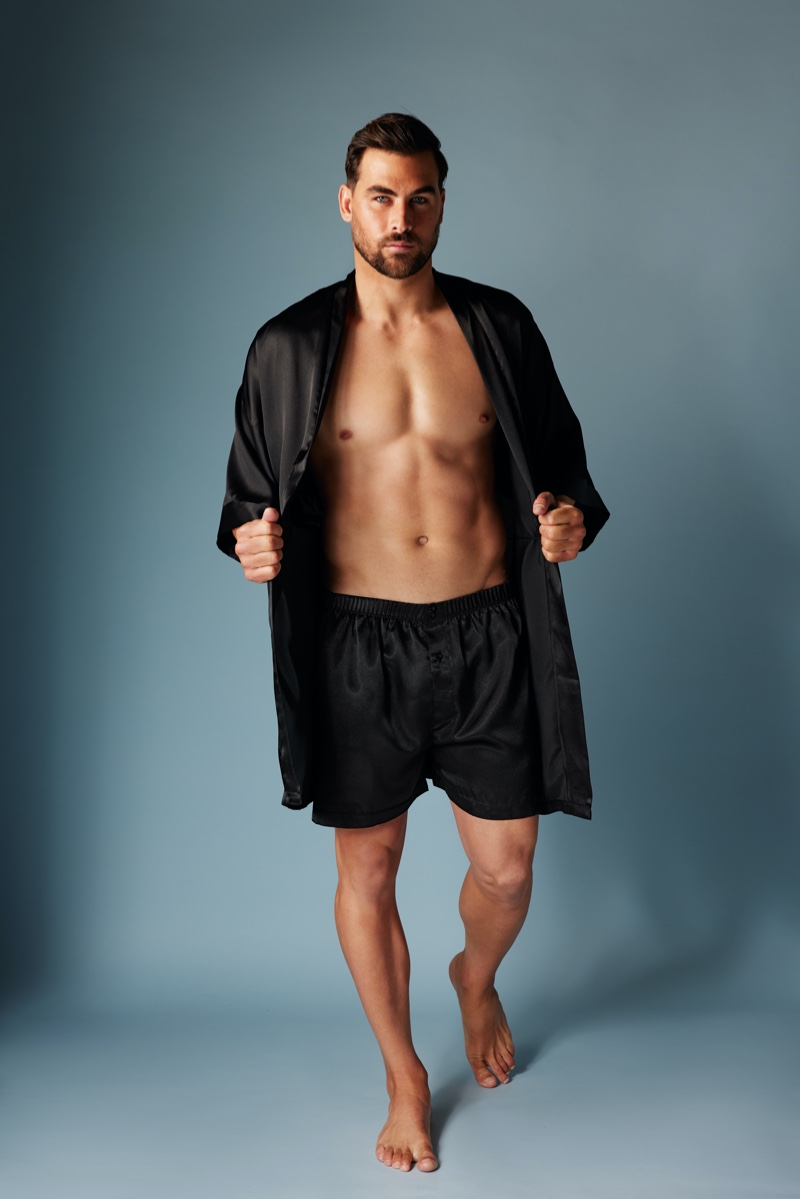Front and center, Marc Jacobs sports a matching satin robe and boxers in black from Frederick's of Hollywood.