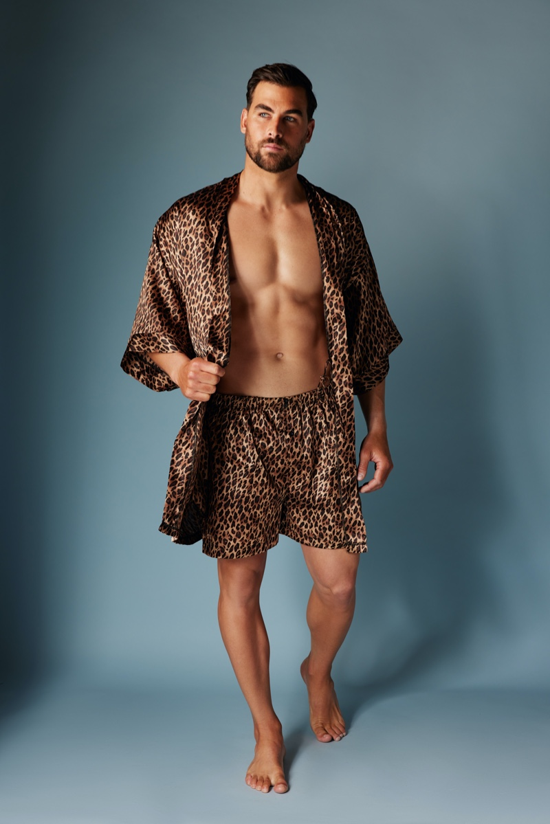 Making a bold statement, Marc Jacobs models a matching satin leopard robe and boxers by Frederick's of Hollywood.