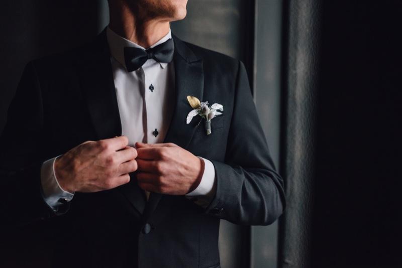 Groom Adjusting Suit Cropped