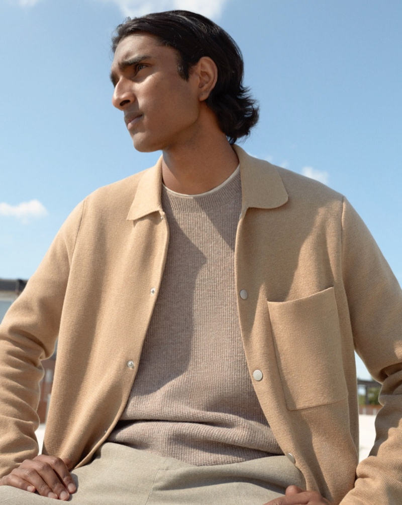 A chic vision, Jeenu Mahadevan wears a cardigan with a lightweight sweater from H&M.