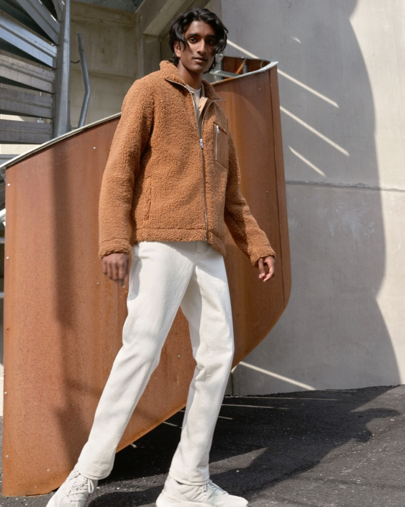 Connecting with H&M for the season, Jeenu Mahadevan models a brown faux shearling jacket.