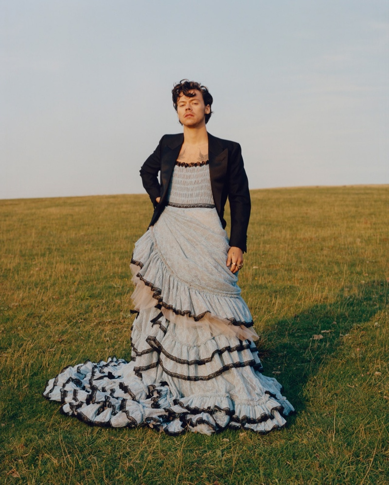 Harry Styles dons a dress and tuxedo jacket from Gucci for the pages of American Vogue.