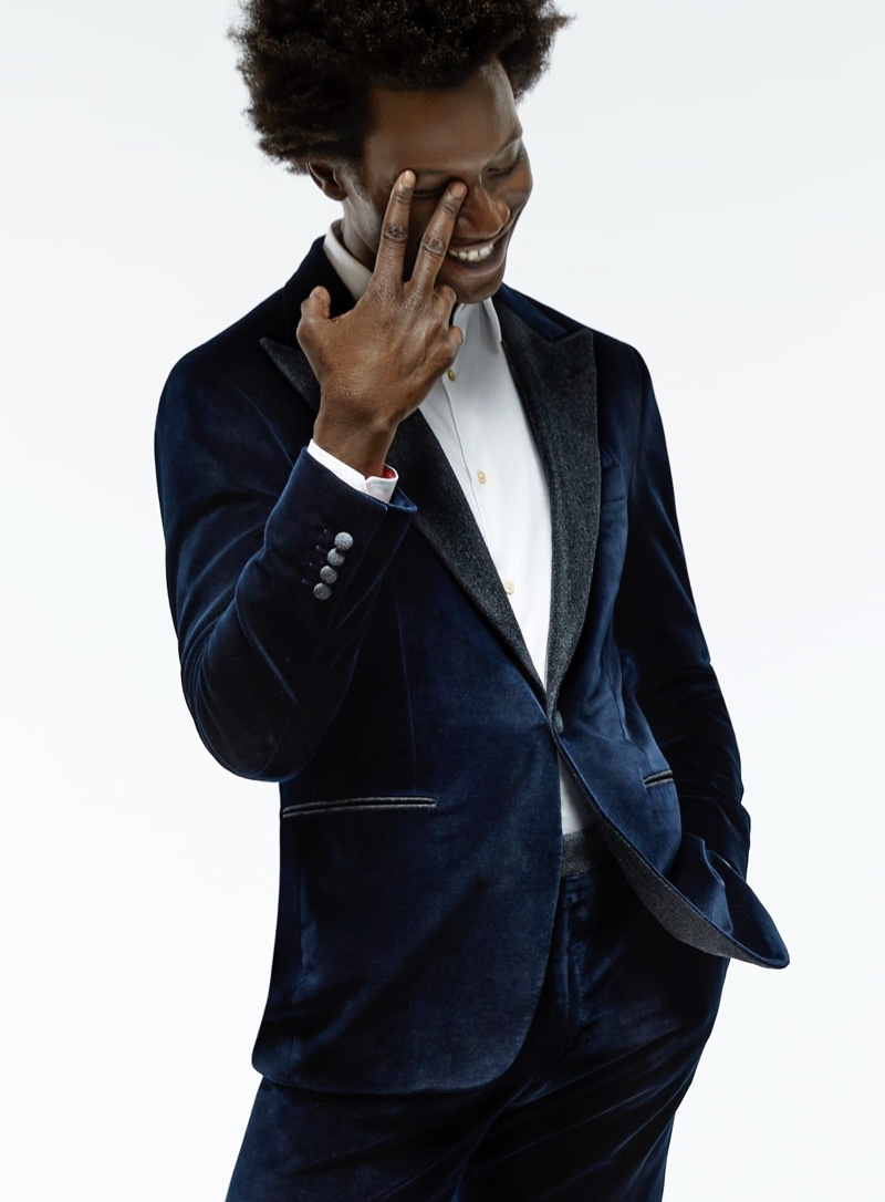 All smiles, Adonis Bosso wears a Canali velvet tuxedo jacket for Holt Renfrew's fall-winter 2020 campaign.