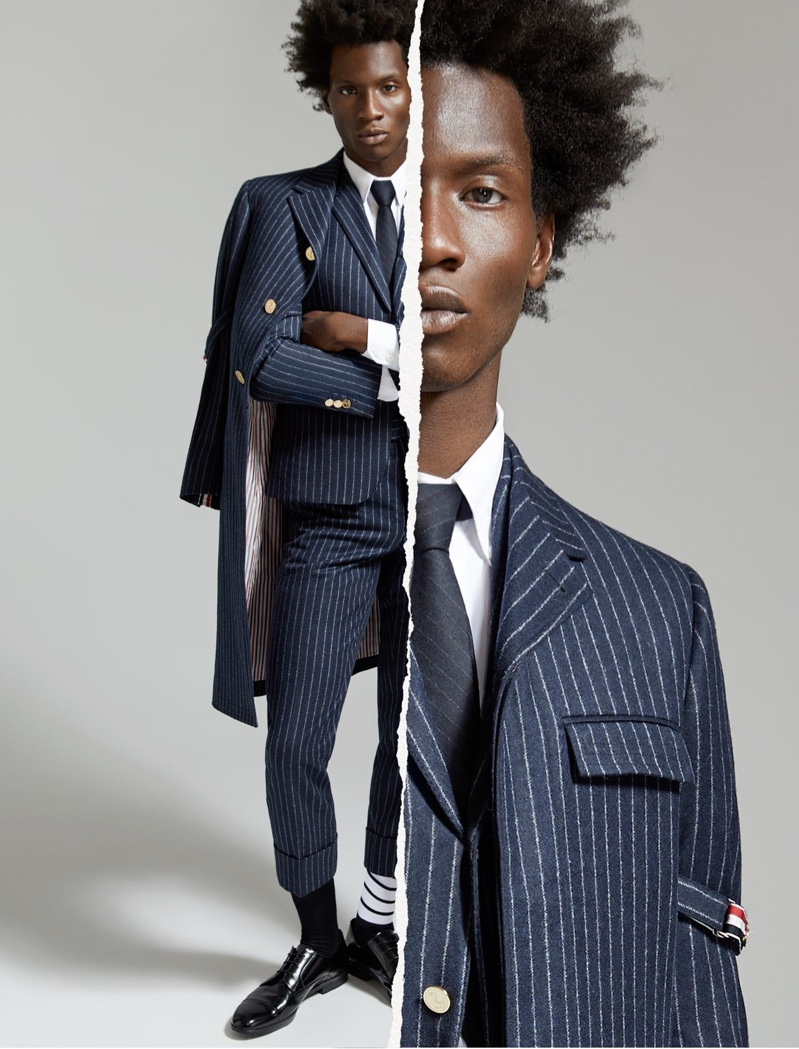 Making a sartorial statement, Adonis Bosso dons a pinstripe wool suit and coat by Thom Browne for Holt Renfrew's fall-winter 2020 campaign.
