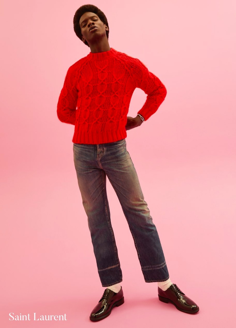 Front and center, Adonis Bosso rocks a red cable-knit sweater by Saint Laurent for Holt Renfrew.