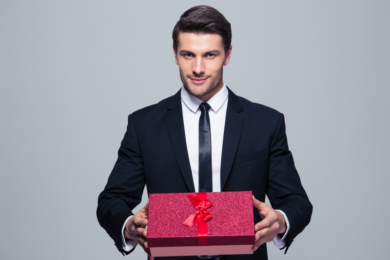 Male Model Suit Holding Red Gift Box
