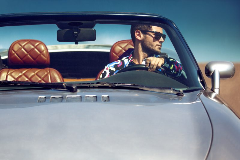 Man Driving Luxury Car