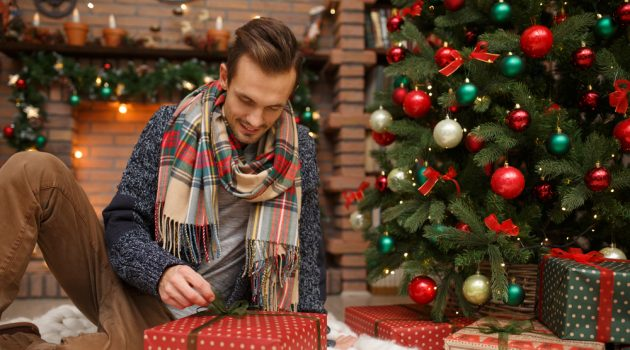 Man Opening Christmas Presents