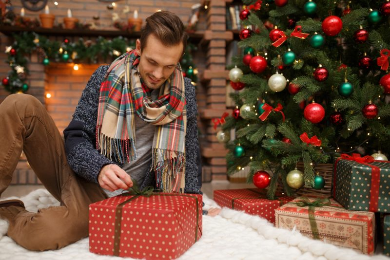 Man Opening Christmas Presents
