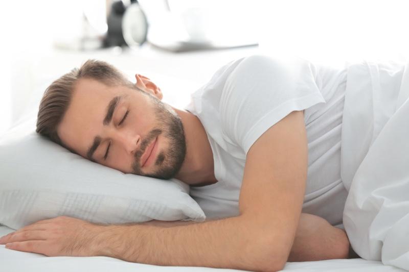 Man Smiling Sleeping Pillow Bed
