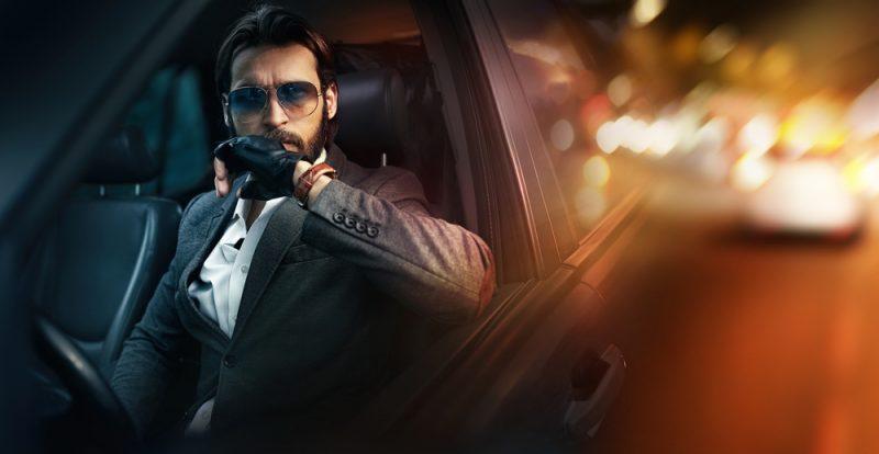 Man in Luxury Car