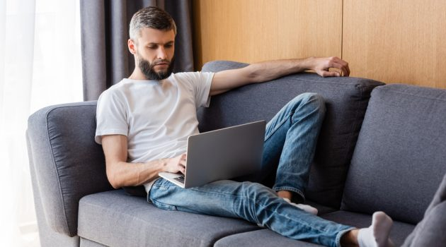 Man on Couch on Laptop