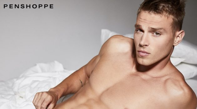 Laying in bed, Matthew Noszka sports black underwear for Penshoppe's Core campaign.