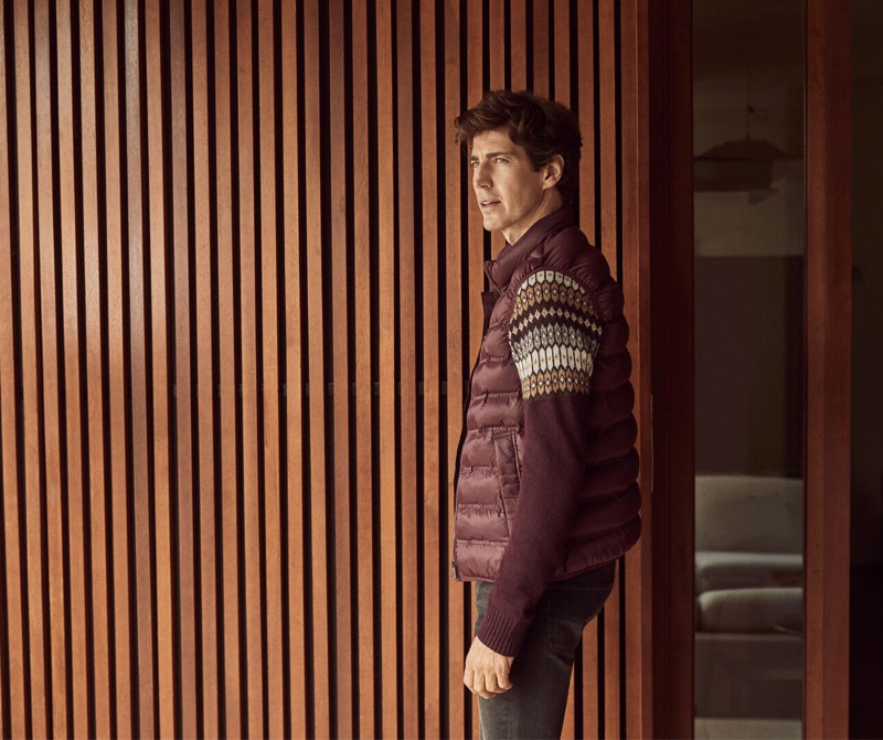 Reuniting with Pedro del Hierro for fall, Oriol Elcacho wears a burgundy-colored sweater with a matching quilted vest and grey cashmere feel jeans.