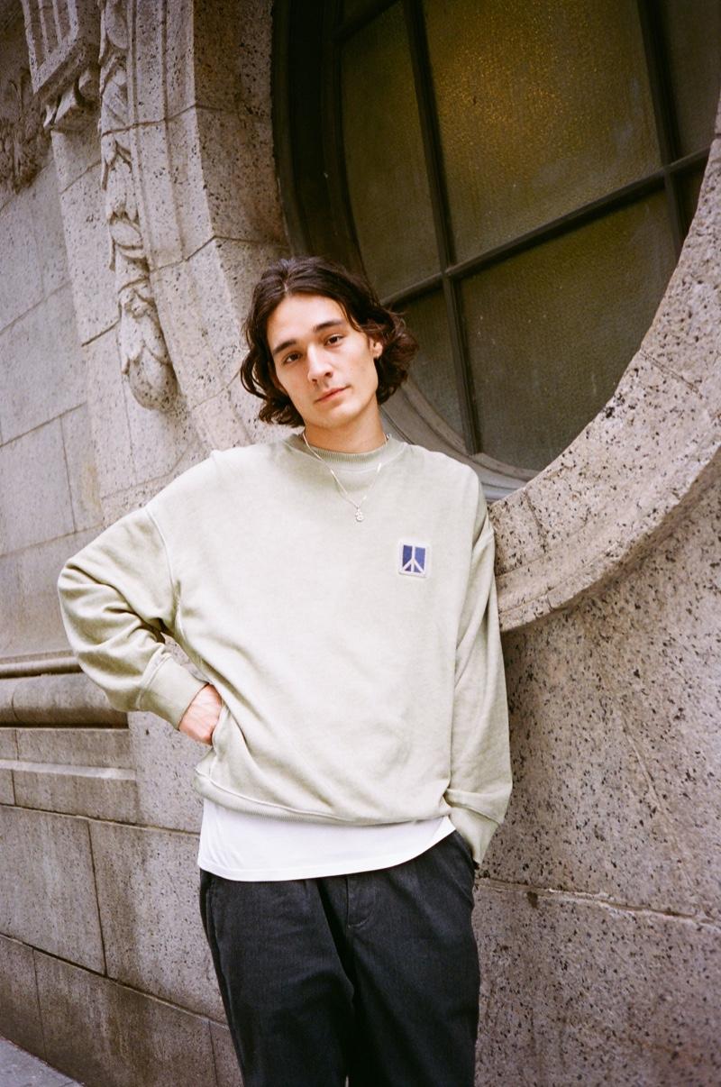 Keeping it casual, Sebastião Hungerbühler rocks Saturdays New York City's Peace sweatshirt with Dean trousers.