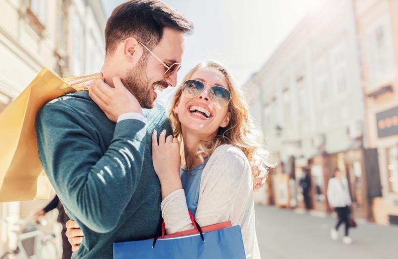 Smiling Couple Shopping Bags Outside