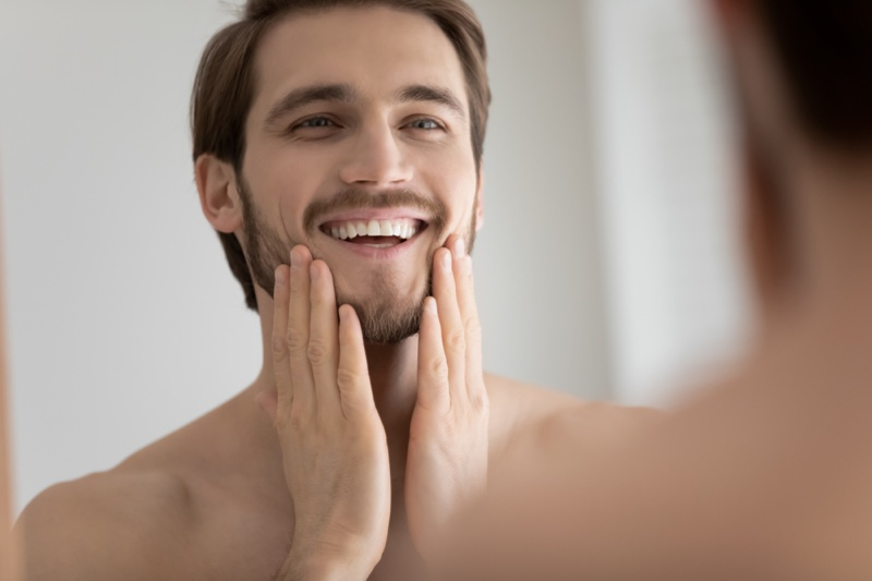 Smiling Man Mirror Grooming Skin