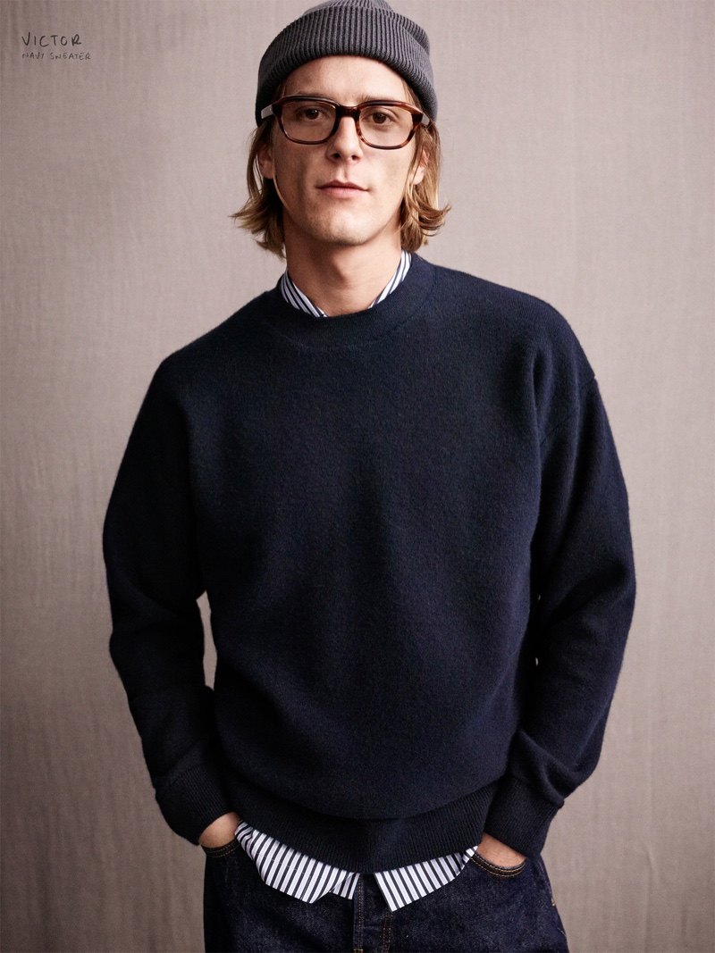 Victor sports a navy sweater from the Zara Edition collection.