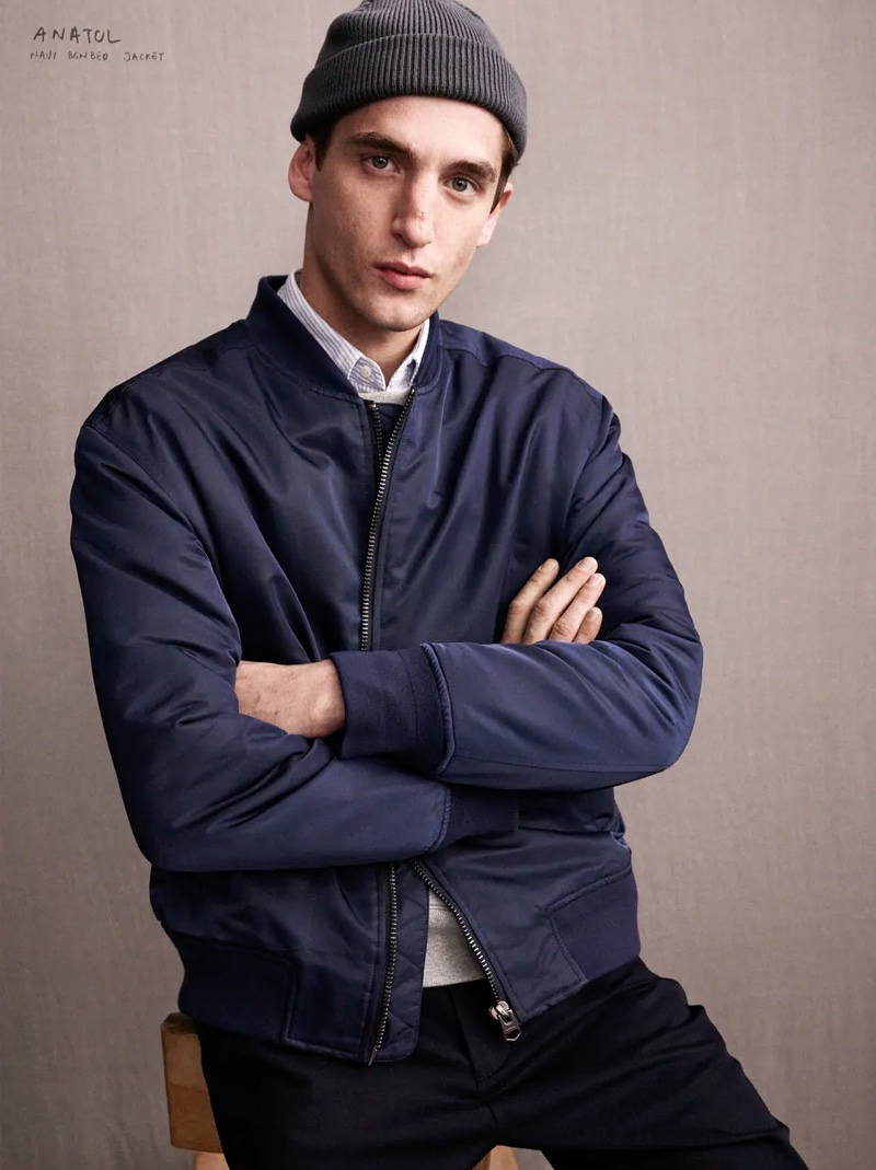 Crossing his arms, Anatol Modzelewski wears a navy bomber jacket from the Zara Edition collection.