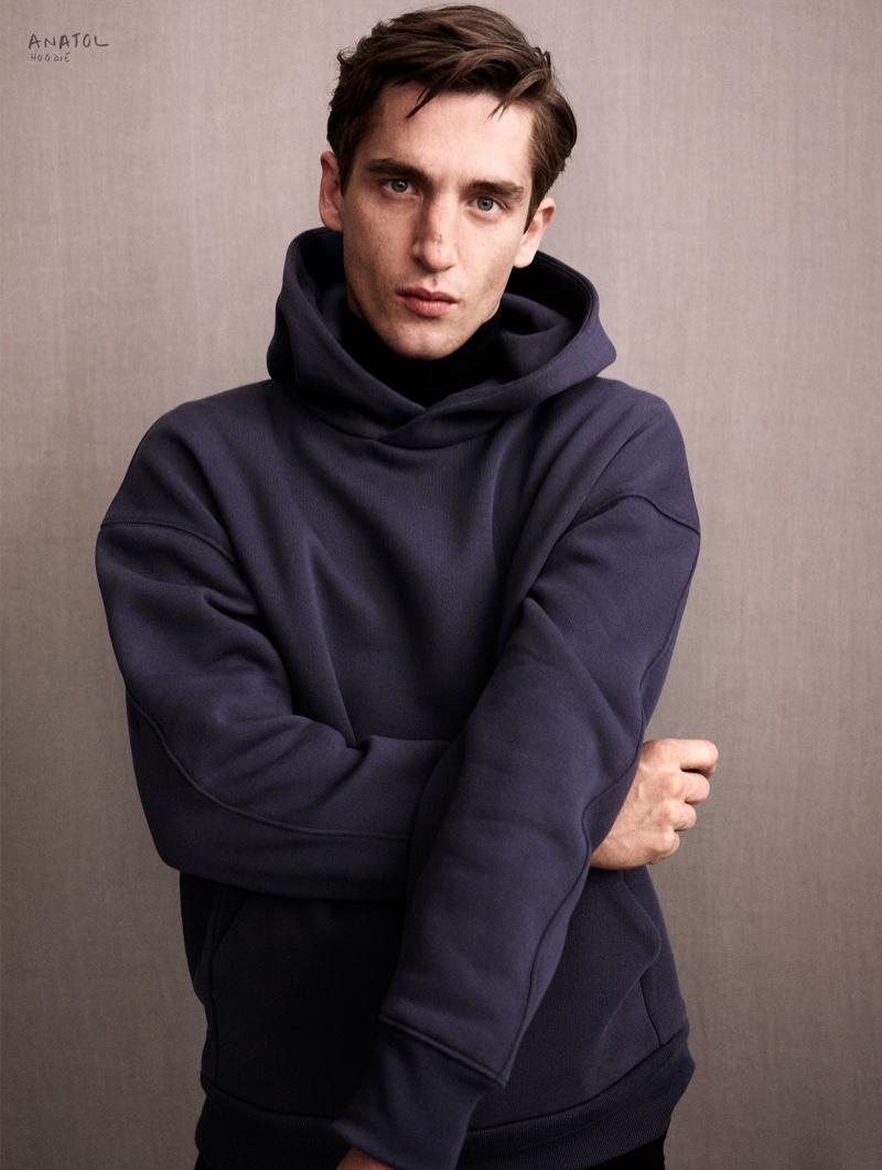 Anatol Modzelewski rocks a Zara Edition hoodie in navy.