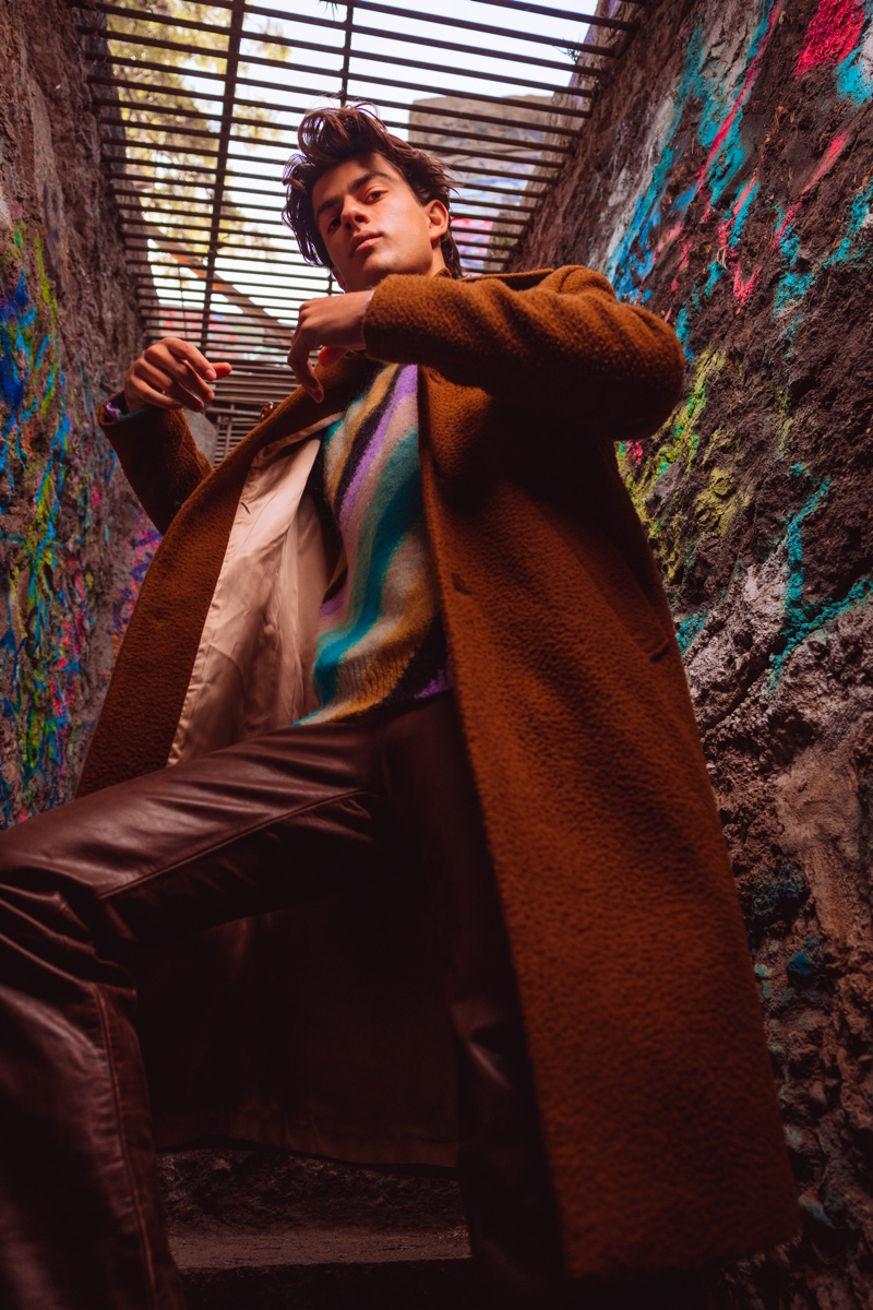 Brent wears coat Séfr, sweater Loewe, leather pants Dulce Bestia, and shoes Dr Martens.