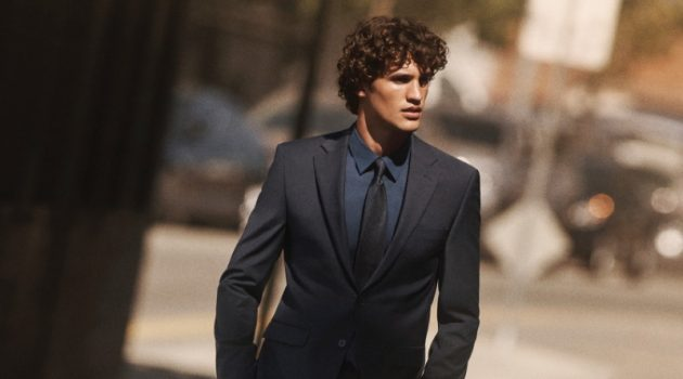 Francisco Henriques dons a sleek suit, shirt, and tie for Calvin Klein's fall-winter 2020 campaign.