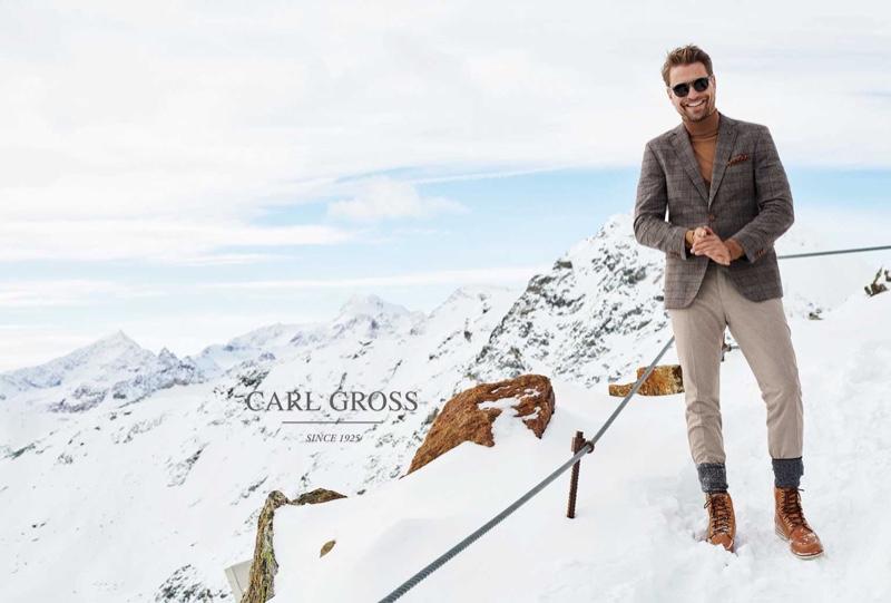 All smiles, Bertil Espegren wears a fall-winter 2020 ensemble from Carl Gross.